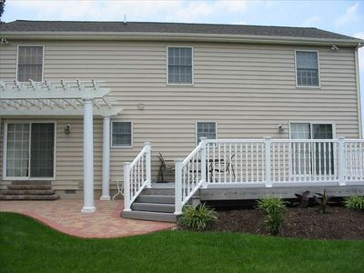 Backyard with Large Deck, Patio Furniture, & Gas Grill