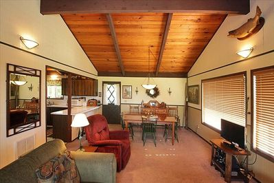 Note the warm knotty pine ceilings. Stereo and HD TV too. Sunny westside view!