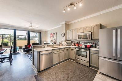Full Kitchen with large and small appliances, dishes, baking tools and pots/pans