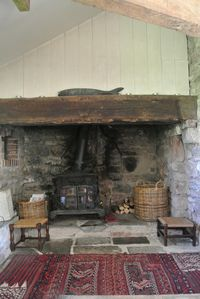 The large inglenook fireplace with Esse Dragon wood burning stove.