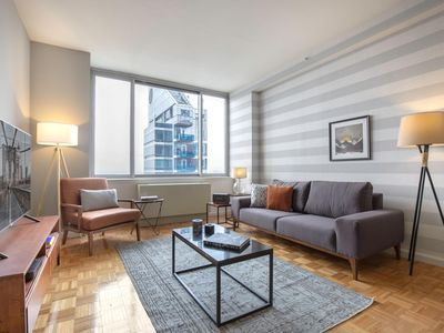 Photo for Cozy Midtown West 1BR w/ roomy sundeck, Gym, near Times Sq by Blueground