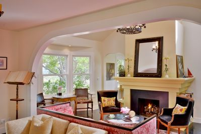 You're greeted by a gas fireplace and cozy, sunny rooms with sky lights