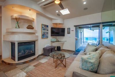 Living room Includes TV and Fireplace.