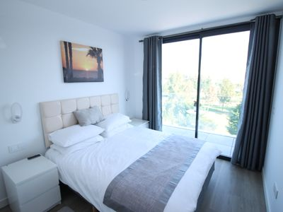 Photo for Newly constructed 3 bedroom Apartment with golf views, 10 minute walk to beach