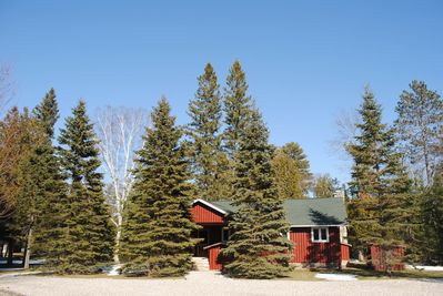 Welcome home to Pine Bend Cottage, the premier Up North oasis on AuSable River!