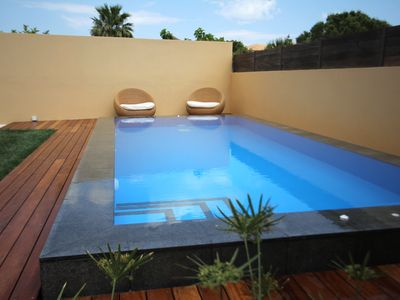 Photo for Lida Garden Vila, featuring a garden witw a swimming pool and BBQ facilities....