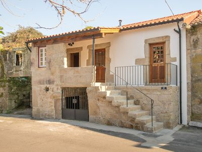 Photo for Holiday home with private pool in the village of Santa Comba near Ponte de Lima