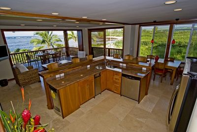 Professional Gourmet kitchen with Pocket Doors that open wide to the ocean