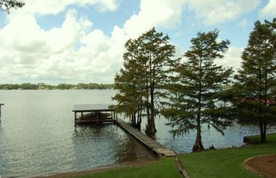 Private dock with sandy beach area, perfect for swimming in the lake