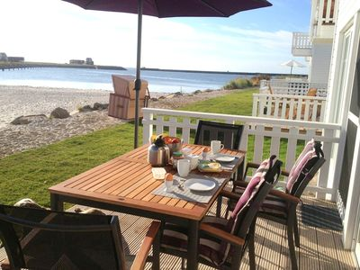 Photo for 5 star holiday home with direct beach access, terrace and WIFI for families