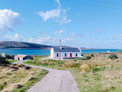 Photo for Right by the sea  with panoramic view - Stunning Cottage Drimlaghdrid