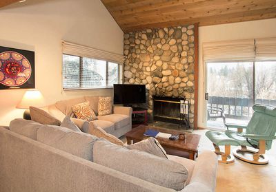 Modern rustic living room with stone fireplace
