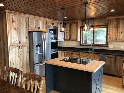 Newly Updated Kitchen w/ Hickory Cabinets, Hickory Floor and Granite.