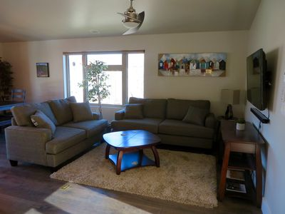 Living room with big screen TV, Bluetooth sound bar, cable, WIFI & DVD movies