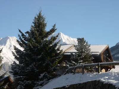 Photo for Lovely Alpine chalet near ski bus stop, fabulous views, tablet pcs, free WiFi