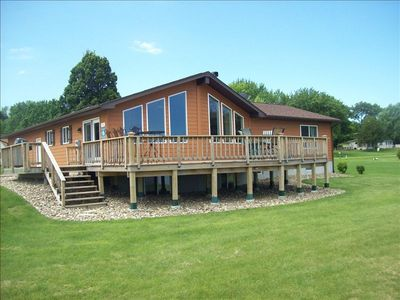Large deck to enjoy this lake front location