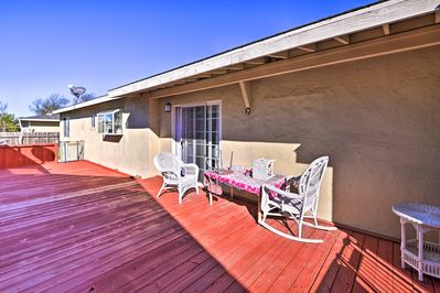 This 3-bed, 2-bath vacation rental house offers a spacious deck!