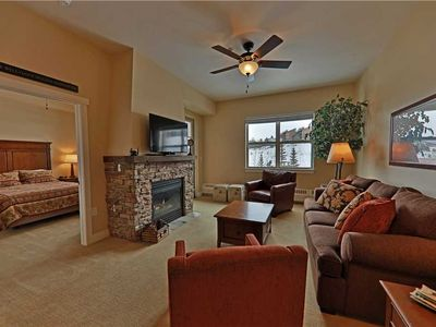 Photo for Delightful ski-in/ski-out condo with gorgeous fireplace and stellar views