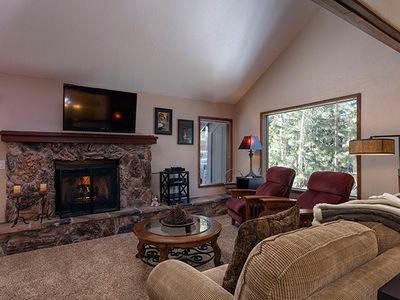 Enjoy the fireplace and tree-house view