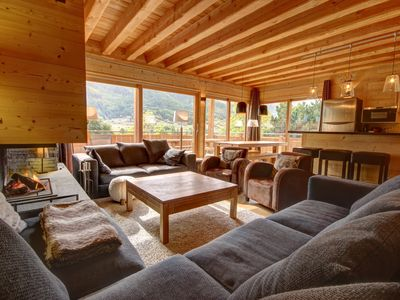 Photo for Apartment in new chalet, charm and luxury, fireplace, terrace full sun,