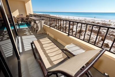 Spacious balcony with seating for all - Some of the largest balconies on Okaloosa, Surf Dweller condos have lots of room for all guests