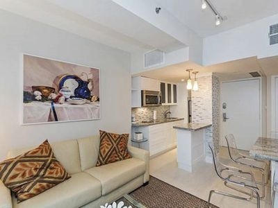Photo for Beautiful 1 bedroom POOL condo in art deco district-walk to beach