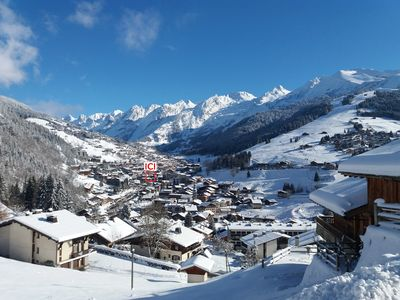 Photo for Apartment ***, wifi, parking, in the heart of the village of La Clusaz