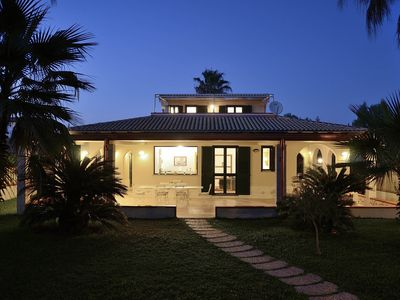 Photo for Villa with direct access to the sandy beach, and garden terraces
