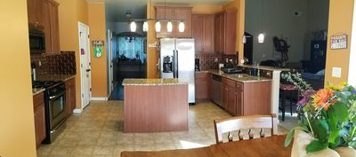 Kitchen with 4 bar stools, gas range, vented hood