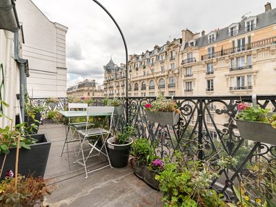 Photo for Modern and leafy 1BR with balcony, walking distance from Bastille, by Veeve