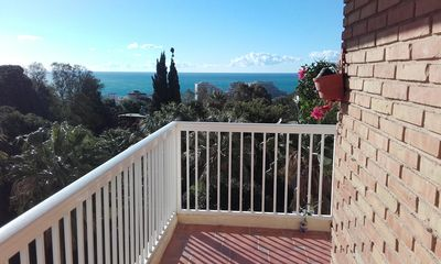 Photo for One bedroom sunny corner apartment with pool view