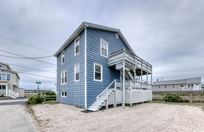 Photo for Beach-themed home w/ ocean views! Just a block from the water!