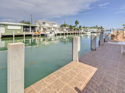 Photo for NEW LISTING! Waterfront dog-friendly cottage with dock & amazing canal views!