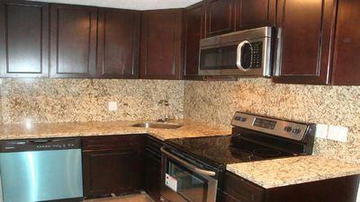 Kitchen includes brand new appliances with stainless and granite counter tops.