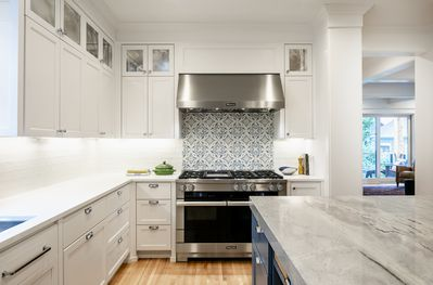 """Chef's kitchen features 48"""" Miele range with griddle."""