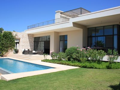 Photo for Modern Villa with Unique Golf and Beach view