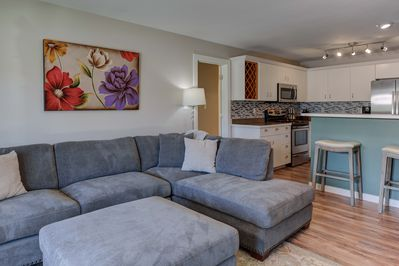 Main living space, large L couch, gas fireplace, 50in flat screen