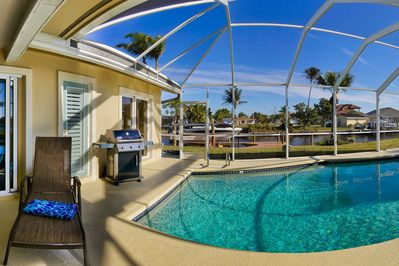 Relax poolside, viewing dolphins in our canal!