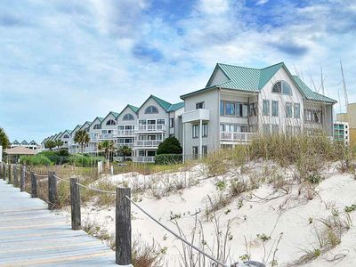 Photo for NEW LISTING! Couples Retreat! Beachfront condo w/pool, hot tub, gym & beach