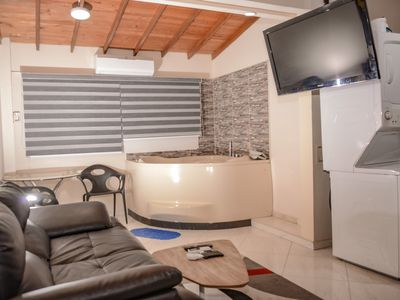 Photo for Hot tub, AC 1 bedroom Calle 8 3 blocks from Lleras. Apt 303