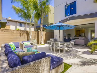 Photo for ☀️Luxury Relaxation w/ A/C • Roof Deck • Large Back Patio • 4 Blocks to Beach