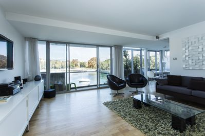 Living area with waterfront balcony