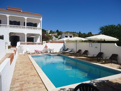 Photo for Holiday Apartment 'Bougainvillea' - with swimming pool - right on the beach Meia Praia