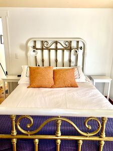 Solid iron and brass full bed. Down duvet and flannel sheets to keep you toasty.