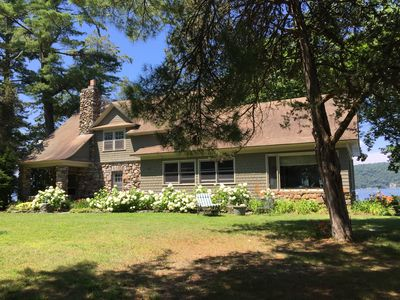 Spacious main house has 4 bedrooms, 2.5 baths & waterside screened porch.