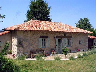 Photo for Beautiful cottage with private pool near Riberac in the Dordogne