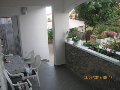 Photo for Three bedroom apartment with terrace and sea view Tisno, Murter (A-11313-b)