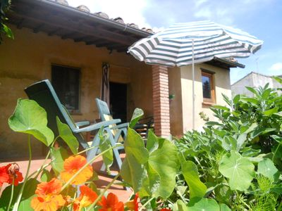 Photo for Romantic holiday house with enclosed garden in an enchanting village,