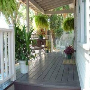 Porch has Breakfast Table & hammock to relax in