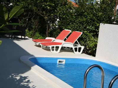 Photo for 200 m to the beach, sea view, shared outdoor pool, 2 people, free WiFi, parking